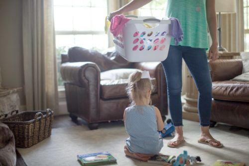 mom decluttering with child