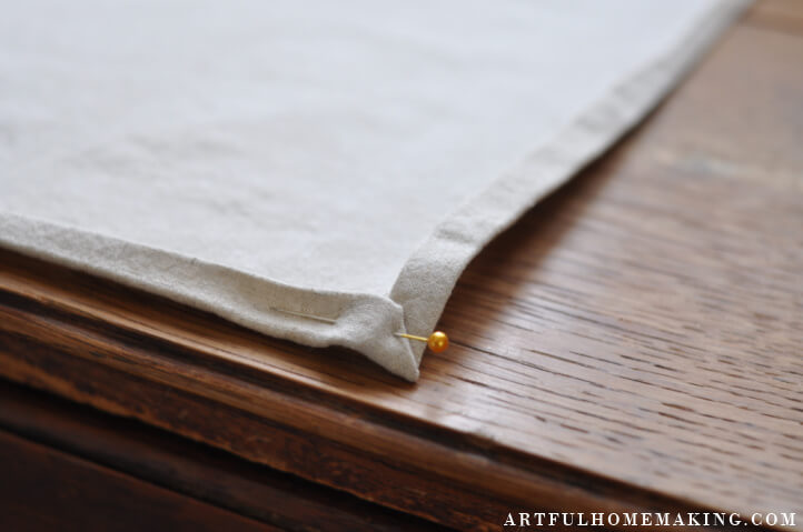 pinned mitered cloth napkin corner